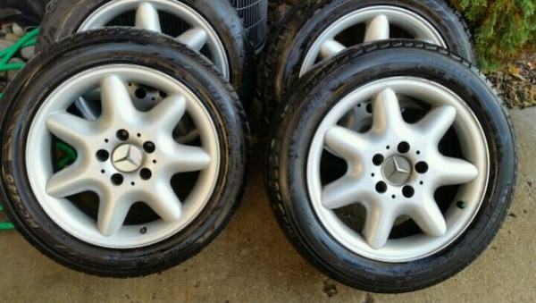 two gray 5-spoke vehicle wheels and tires
