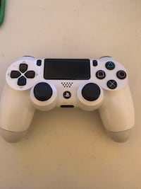 white and black Sony PS4 DualShock 4 590 km