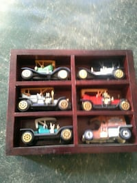 six die-cast toy cars