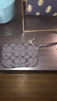 gray Coach leather monogram print wristlet