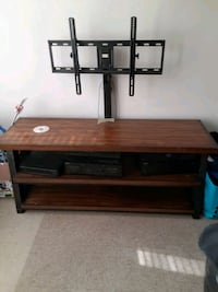 Tv stand for a flat screen it holds from a 55 inch to a 65 inch