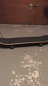 black and brown skateboard deck Laval, H7W 2S9