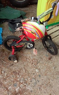 toddler's red bicycle with training wheels and helmet Windham, 04062