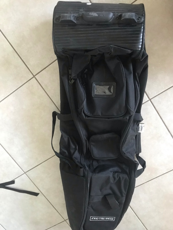 Golf travel bag, excellent condition, only used two times.  Many compartments even one for your golf shoes. aeb34fe5-1227-443e-8ff1-957fd505e255
