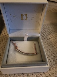 silver-colored chain necklace with box