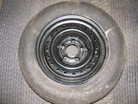 "New and unused 15"" rim  and tire"
