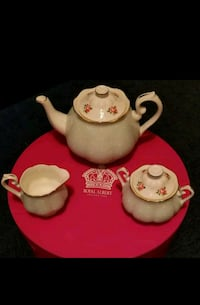 white and red ceramic teapot and cups null