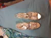 pair of silver-colored heeled sandals