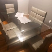 origanally 2k 6 chair glass top dining table selling for 1k