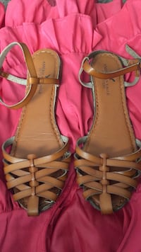 Pair of brown leather sandals 879 mi