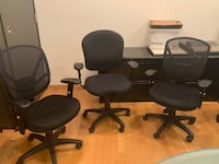 four black leather rolling chairs Toronto, M4V 1P7