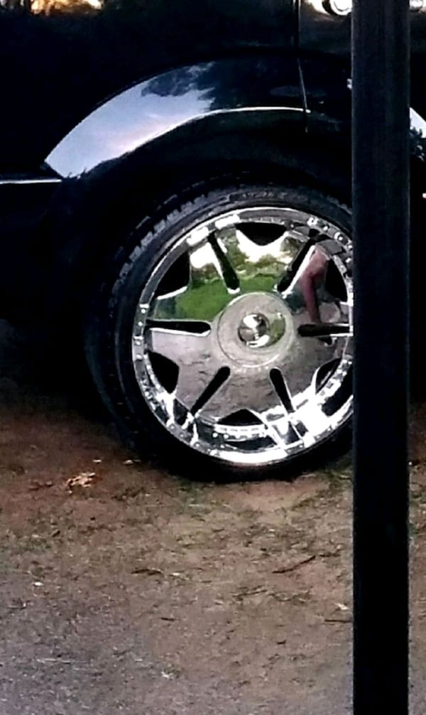 A set of 20 inch rims and tires  0