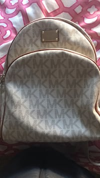 gray and white Michael Kors leather backpack 2412 mi