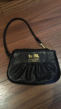 Black leather Coach clutch Guelph, N1C 1G6