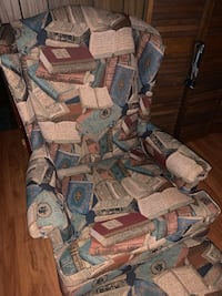 Wing back arm chair with foot rest