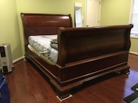Brown wooden bed frame with white mattress Gainesville, 20155