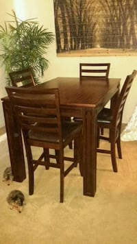 rectangular brown wooden table with six chairs din Longwood, 32779