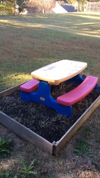 Blue and red plastic picnic table