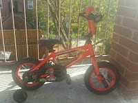 toddler's orange bicycle with training wheels Ontario, M8V