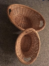 two oval brown wicker baskets