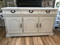 white wooden cabinet with drawer