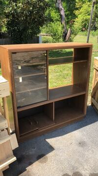 brown wooden TV hutch with flat screen television Southside, 35907