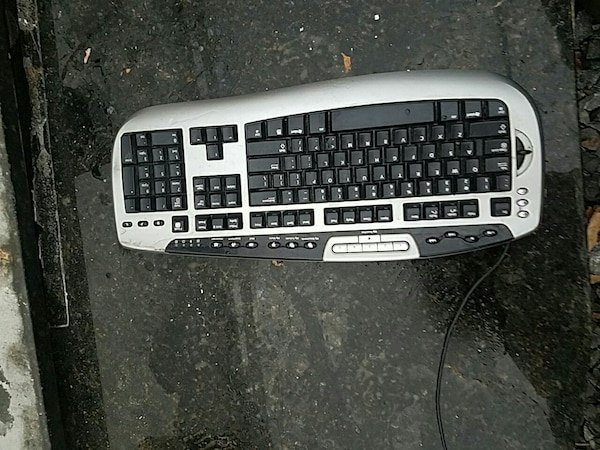 black and gray corded keyboard