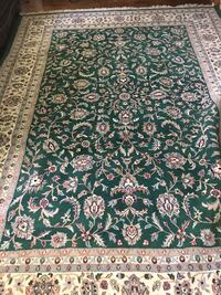 Green, white, and brown floral area rug 43 km