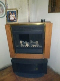 brown wooden framed electric fireplace Chicago, 60639