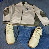 gray Oakland Raiders zip-up jacket and pair of beige lace-up sneakers