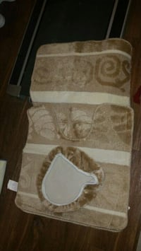 white and brown area rug