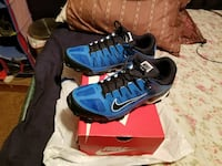 black-and-blue Nike athletic shoes with box
