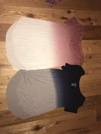 Two black and white crew-neck shirts Summerville, 29486