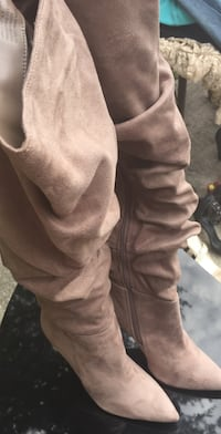 pair of brown suede boots 831 mi