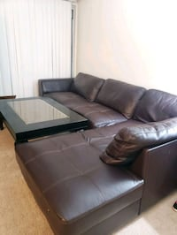 Leather 2 piece sectional sofa with coffee table.