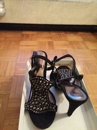 pair of black studded heeled sandals with white bo Toronto, M3N 2T8