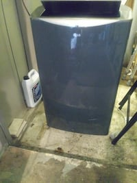 black and gray compact refrigerator 1149 mi