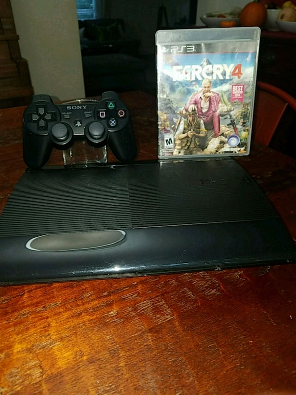 black Sony PS3 super slim console and games