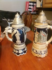 two white-and-black beer steins