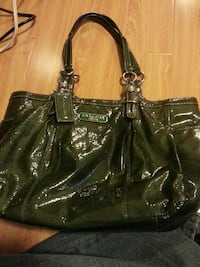 women's black leather Coach handbag