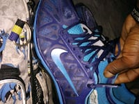 pair of blue Nike running shoes Seattle, 98134