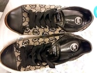 pair of black-and-white Converse sneakers 161 mi