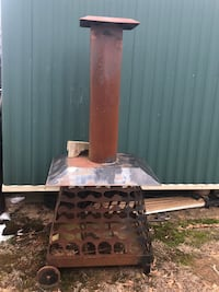Fire pit on wheels. Just needs some TLC OBO Minden, 71055