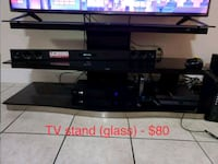 black flat screen TV with remote Pembroke Pines, 33025
