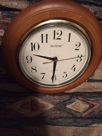 Round brown wooden framed skytimer analog wall clock