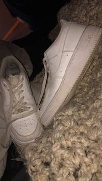 pair of white Nike Air Force 1 low shoes