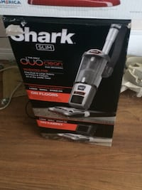 black and gray Shark upright vacuum cleaner with box Edmonton, T5R 2W7