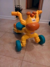 yellow and blue Little Tikes ride on toy Arnold, 21012