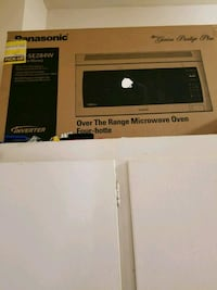 brown Panasonic over the counter microwave  550 km