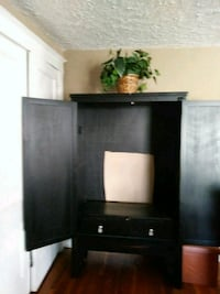 black wooden TV stand with flat screen television Kansas City, 64109